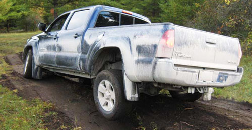 The Tacoma (2008 overall winner) navigates the off-camber course designed to demonstrate the ability of each trucks 4WD system. Often with two wheels in the air the truck (with open differentials) will come to a complete halt.
