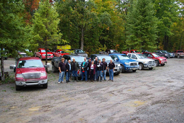 This years Judges and Facilitators in front of the assembled trucks at the IronWood facility on Head Lake, Ontario
