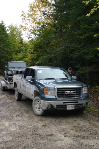 Journalist and Judge Clare Deere testing the Sierra. Towing a Jeep for a combined weight of 7000 lbs